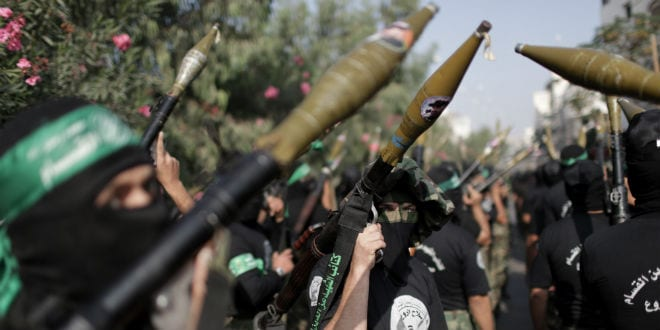 Palestinian militants of the Ezzedine al-Qassam Brigades, Hamas's armed wing, stage an anti-Israel parade as part of the celebrations marking the first anniversary of an Israeli army operation in the Gaza Strip, on November 14, 2013. A year after trading fire in a week-long war in Gaza, in which more than 170 Palestinians and six Israelis were killed, Israel and Hamas are squaring up for another confrontation, despite both sides appearing reluctant to make the first move. (Photo: Wissam Nassar/Flash90