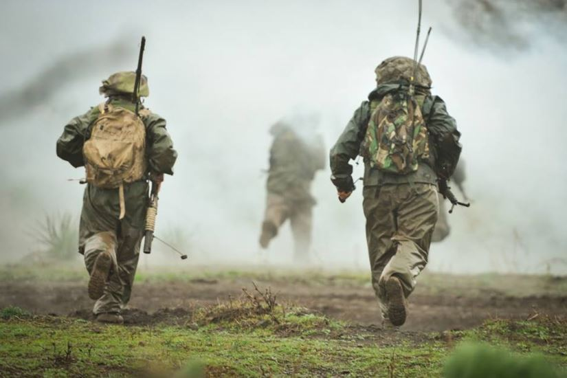 IDF 10 Soldiers navigating through the smoke of the simulated explosion.