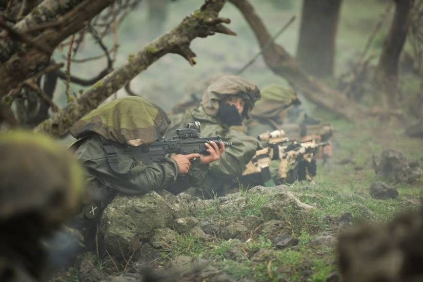 IDF 11 Soldiers practice firing from all sorts of positions and in different situations.