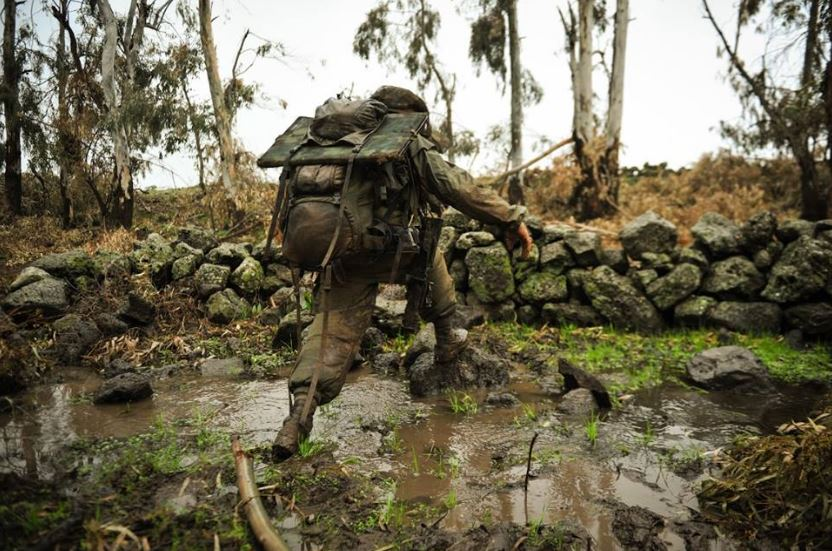 IDF 12 This soldier managed to cross the muddy stream. It's not such an easy task with all of that heavy gear!