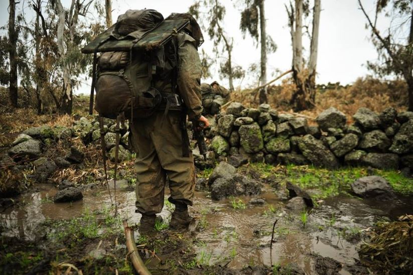 IDF 13 About to cross the muddy stream. It's not such an easy task with all of that heavy gear!
