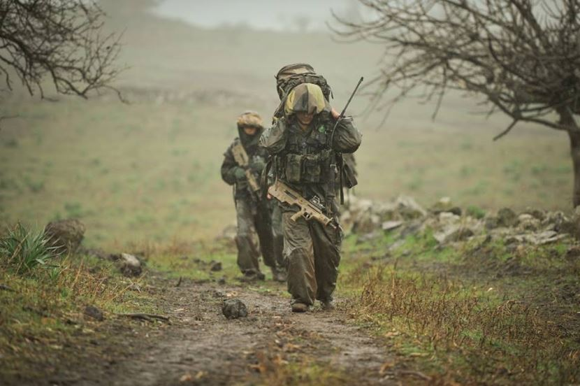 IDF 3 Carrying the heavy gear becomes even harder when they have to do it through mud and rain.