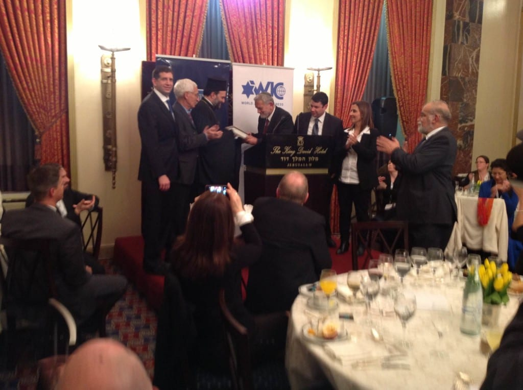 Father Gabriel Naddaf accepting his award. (Photo: Knesset Christian Allies Caucus)
