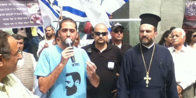 Father Nadaf (far right) attending the protest. (Photo: Christian Lobby/ Tazpit News Agency)
