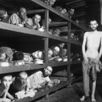 Jewish slave laborers in the Buchenwald concentration camp near Jena, Germany. April 16, 1945. Elie Wiesel can be seen second row from bottom, seventh from left. (Photo: NARA image ARC #535561)
