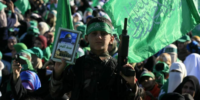 A Palestinian child holds up a toy guy during a pro-Hamas rally in the Gaza Strip. (Photo: Wissam Nassar/ FLASH90.