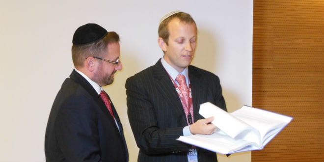 MK Dov Lipman being presented with the Jerusalem Covenant by Rabbi Tuly Weisz from Israel365. (Photo: Breaking Israel News)