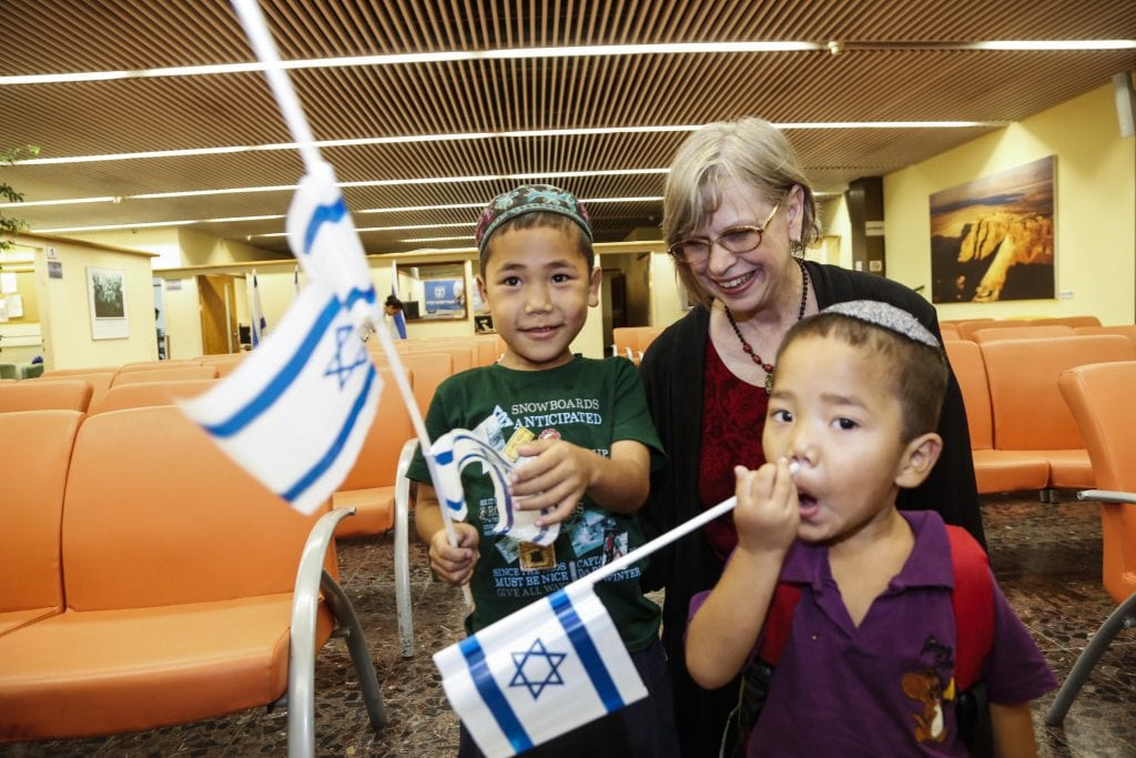 "Becky Brimmer from ""Bridges for Peace"" with children of the Bnei Menashe (Photo: Israel Returns)"