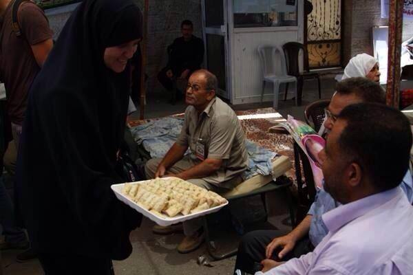 A Palestinian woman in Gaza hands out cookies in celebration of the kidnapping. (Photo: Facebook)