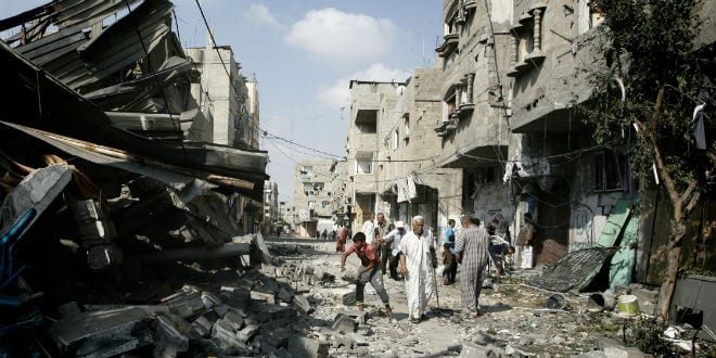 Palestinians inspect the destruction in Farouq Mosque after it was hit in an Israeli air strike, in Rafah, southern Gaza Strip on July 22, 2014. (Photo: Abed Rahim Khatib/Flash90)