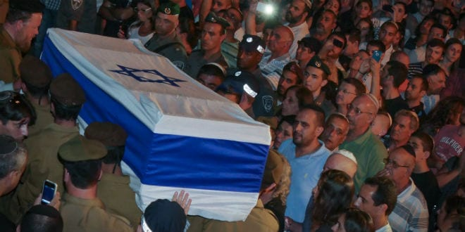 Some dozens of thousands of Israelis attend the funeral of IDF soldier Nissim Sean Carmeli, from Texas, at the military cemetery in the northern Israeli city of Haifa, Monday, July 21, 2014. Carmeli was killed in Northern Gaza Strip on July 20th during clashes with Hamas militants during the Israeli ground operation in the Gaza Strip. (Photo: FLASH90)