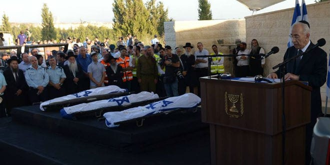 Shimon Peres eulogizes Eyal, Gilad and Naftali as their flag draped bodies rest nearby. (Photo: GPO)