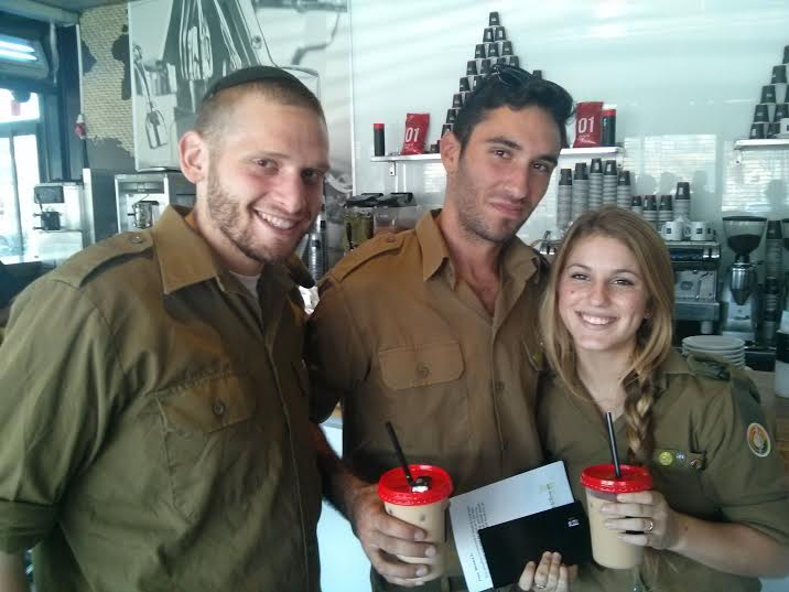 Handing out letters and gift cards to soldiers of the IDF as a sign of love and support. (Photo: Breaking Israel News)
