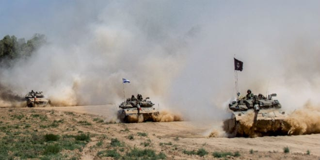 Israeli Merkava tanks pull back from the Gaza Strip near the border with Israel on August 3, 2014. Ground troops withdrew from the Gaza Strip as Israel wrapped up an operation to destroy tunnels, but airstrikes continued, killing at least 15 Palestinians. A military official said that most combat troops were back in Israeli territory by the morning. (Photo: Flash90)