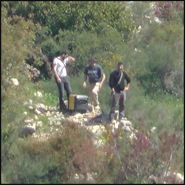 In a newly released photo by the IDF, Hezbollah operative are spotted near the northern border with Israel, 2014. (Photo: IDF)