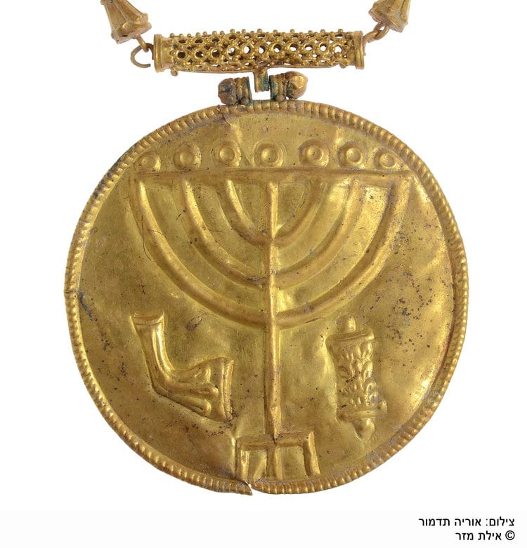 This golden medallion featuring inscriptions of a menorah, shofar, and Torah scroll was on display for the very first time during the the City of David Foundation's annual conference on Sept. 4 in Jerusalem. The medallion was found in the Ophel excavation south of the Temple Mount and was believed to have been hung on a Torah scroll as a breast plate. (Photo: Eilat Mazar/City of David Foundation)