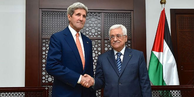 US Secretary of State John Kerry shakes hands with Palestinian Authority President Mahmoud Abbas in Ramallah on July 23, 2014, before the two sat down for a discussion about a cease-fire in fighting between Israel and Hamas in the Gaza Strip. (Photo: US State Department)