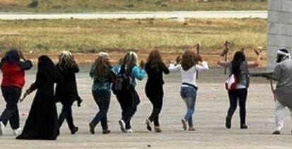 Yazidi women being rounded up by ISIS.