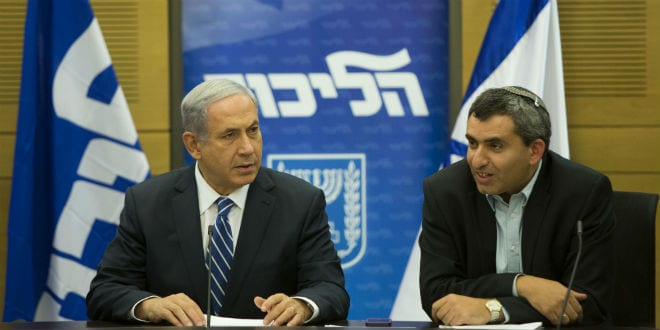 Israel's Prime Minister Benjamin Netanyahu (L) sits next to fellow Likud party member Zeev Elkin during a Likud faction meeting at the Knesset, Israel's parliament on November 10, 2014. (Photo: Yonatan Sindel/Flash90)