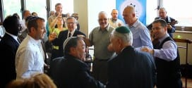 Jews and Gentiles dancing together during Feast of Tabernacles service. Left to right Rabbi Tuly Weisz, Rabbi Shlomo Riskin, Earl Cox and David Nekrutman.