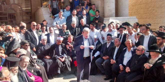Druze clerics, Muslim imams, Baha'i representatives, Armenian patriarchs, Greek Orthodox priests, and the Sephardic Chief Rabbi Shlomo Amar, among others gather together to condemn the brutal attack at the Har Nof synagogue in Jerusalem, Wednesday November 19. (Photo: Anav Silverman, Tazpit News Agency)