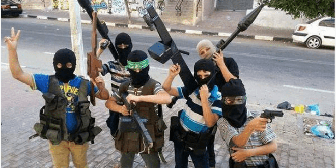 A photo posted online of  Palestinian children dressed as Terrorists. (Photo: Facebook)
