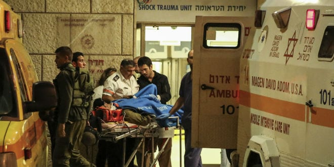 Israeli soldiers being evacuated at the Hadassah Ein Kerem hospital in Jerusalem. Three Israeli soldiers who were injured when a Palestinian driver rammed into the soldiers near the West Bank village of Al Aroub close to the Gush Etzion junction, outside of Jerusalem, in what initial suspicions indicate to be the second terror attack of this kind today. Earlier today a Palestinian man drove his car into a crowd waiting by the Jerusalem Light Rail station of Shimon ha Tzadik, in East Jerusalem. November 05, 2014. (Photo: Hadas Parush/Flash90)