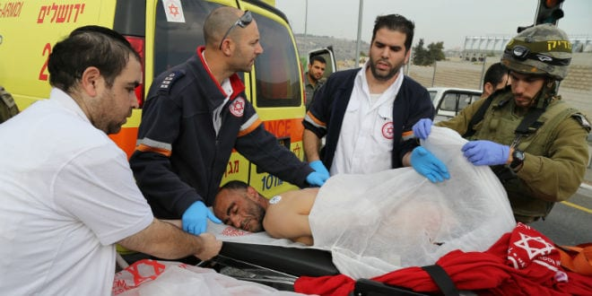 Medics evacuate a Palestinian man after getting shot when trying to attack Israeli civilians with a chemical substance near the Judean city of Neve Daniel in Gush Etzion on December 12, 2014. A Palestinian man threw acid at an Israeli family in Gush Etzion on Friday. (Photo: Gershon Elinson/Flash90)