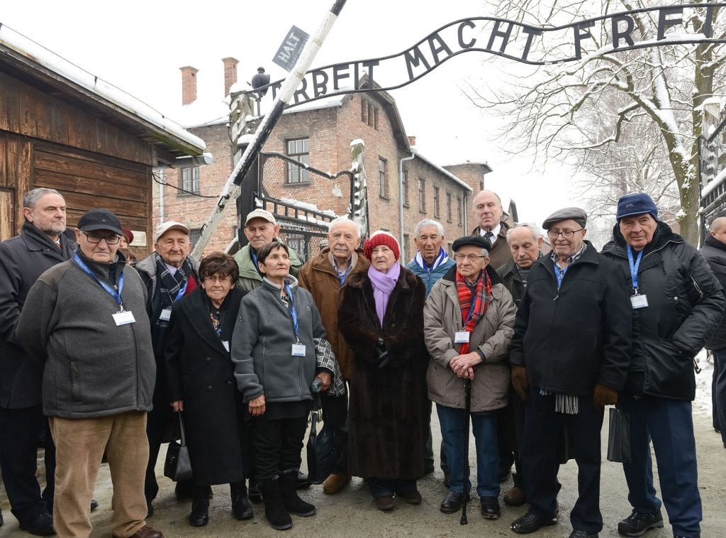 Holocaust survivors return to visit Auschwitz to mark this year's 70 years of liberation. (left to right) Robert Singer, CEO of the World Jewish Congress; Natan Grossman (Germany); Samuel Beller (US); Florence Sprung (US); Manny Buchman (US); Mascha Schainberg (South Africa); Marcel Tuchman (US); Rose Schindler (US); Jonny Pekats (US); Henry Korman (Germany); Ronald Lauder; Mordechai Ronen (Canada); Joseph Madrowitz (US); Edgar Wildfeuer (Argentina). (Photo: Shahar Azran)