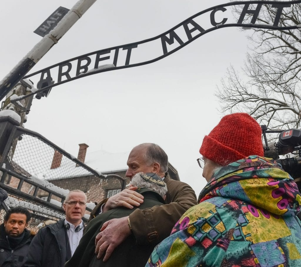 Holocaust survivors return to visit Auschwitz to mark this year's 70 years of liberation. Mordechai Ronen (Canada) hugging Ronald Lauder. (Photo: Shahar Azran)