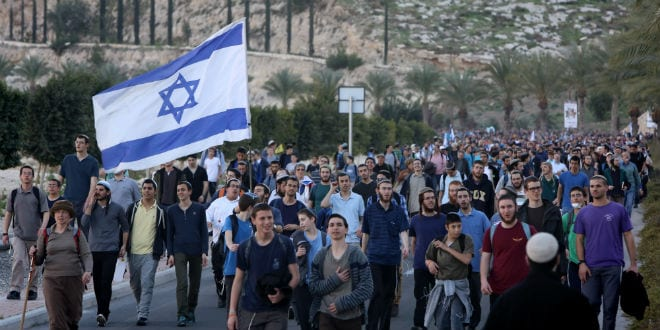 Israeli right wing activists attend a march in the rural area known as E1 from the Israeli city of Ma'ale Adumim, in Judea on February 13, 2014. (Photo: Yonatan Sindel/FLASH90)