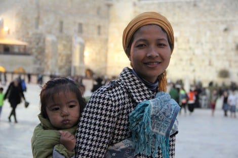 Mother and baby, first time at the Kotel. (Photo: Laura Ben-David)
