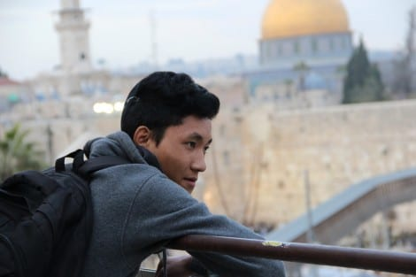 A young man gazes before approaching the Kotel for the first time. (Photo: Laura Ben-David)