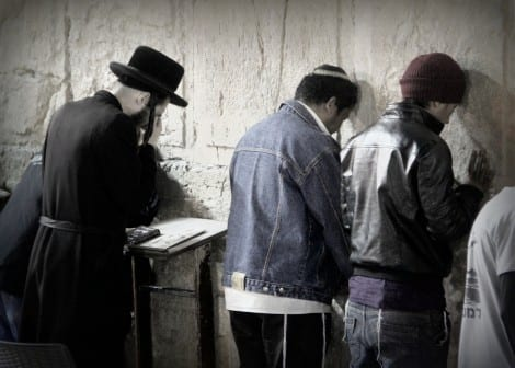 Bnei Menashe men pray at the Western Wall for the first time. (Photo: Laura Ben-David)