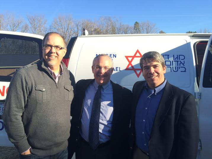 """Pastor Scott Reece -  District Supervisor, Jonathan Feldstein - Heart to Heart Director, Pastor Richard Smith - Restoration Church, Rockwell NC.  Foursquare's Scott Reece of Davidson, NC: """"It was fun dedicating the Heart to Heart ambulance today that's about to be shipped to Israel. We anointed it, prayed over it and sent it on its way!"""" (Photo: Heart to Heart)"""