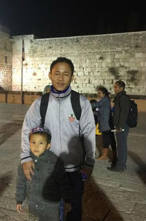 Father and Son from Bnei Menashe smile proudly at the Western Wall. (Photo: Israel Returns)