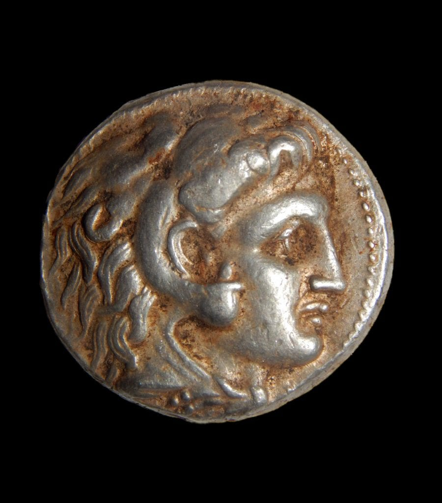 A coin of Alexander of Macedon that was part of the silver cache. (Photo: Shmuel Magal/ IAA)