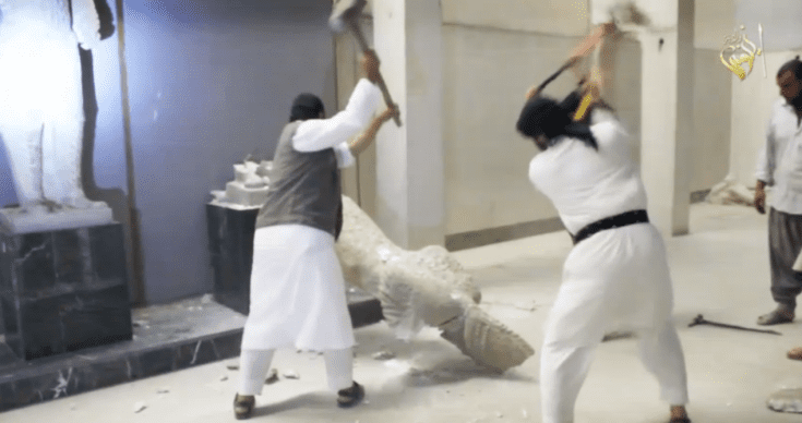 ISIS jihadists destroying ancient artifacts in Mosul.