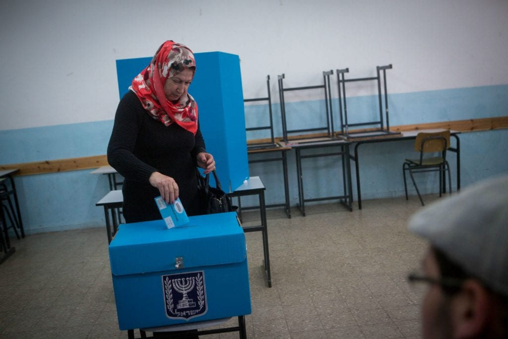 Israeli-Arabs cast their votes at a polling station in the Arab town of Beit Safafa, on March 17, 2015, in the Israeli general elections for the 20th parliament. Photo by Miriam Alster/FLASH90