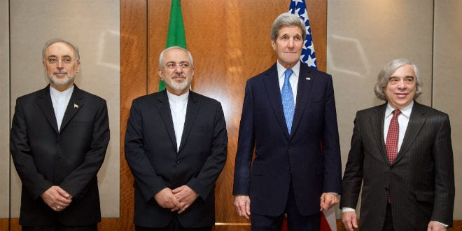 U.S. Secretary of State John Kerry and Iranian Foreign Minister Javad Zarif stand with Dr. Ali Akbar Salehi, the Vice President of Iran for Atomic Energy and President of the Atomic Energy Organization of Iran, far left, and U.S Energy Secretary Dr. Ernest Moniz, far right, on February 23, 2015, in Geneva, Switzerland. (Photo: US Department of State)