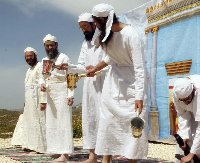Passing the silver Mizrak containing the blood of the offering from kohen to kohen. The blood will be spilled upon the altar.(Photo: The Temple Institute)