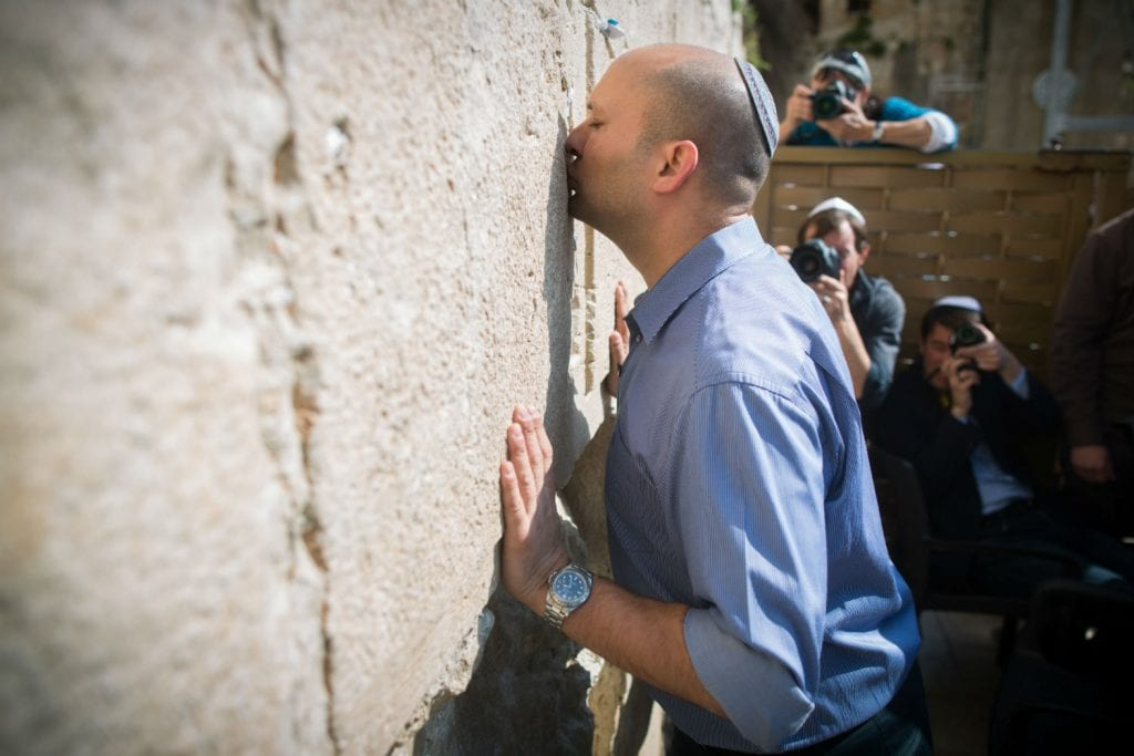 Leader of the 'Jewish Home' political party, Naftali Bennett prays at the Western Wall in Jerusalems Old City on March 16, 2015, prior to the upcoming national Israeli elections held tomorrow. Photo by Yonatan Sindel/Flash90