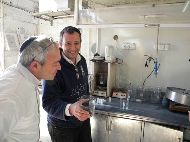 Baruch Sterman (left) and Joel Guberman, two founders of the Ptil Tekhelet non-profit, at the tekhelet factory in Kfar Adumim, Israel. (Photo: Ptil Tekhelet)