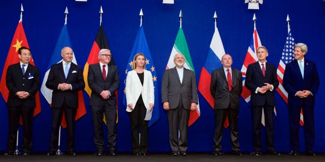 From left, Head of Mission of People's Republic of China to the European Union Hailong Wu, French Foreign Minister Laurent Fabius, German Foreign Minister Frank-Walter Steinmeier, European Union High Representative for Foreign Affairs and Security Policy Federica Mogherini, Iranian Foreign Minister Javad Zarifat, an unidentified Russian official, British Foreign Secretary Philip Hammond, and U.S. Secretary of State John Kerry pose for a photo following negotiations between the P5+1 member nations and Iranian officials about the future of their country's nuclear program at the École Polytechnique Fédérale de Lausanne in Switzerland on April 2, 2015. (Photo: US State Department)