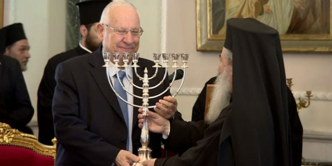 The Greek Patriarch presents Israeli President with silver menorah on Tuesday, April 14. (Photo: YouTube)