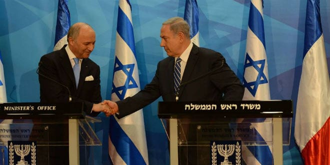 Israeli Prime Minister Benjamin Netanyahu with French Foreign Minister Laurent Fabius. (Photo: Haim Zach/ GPO)