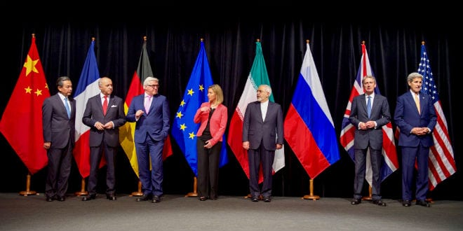 U.S. Secretary of State John Kerry, joined by other European Union and P5+1 countries, stands on the stage at the Austria Center in Vienna, Austria, on July 14, 2015, for a group photo with Iranian Foreign Minister Javad Zarif after the parties reached agreement on a plan to prevent Iran from obtaining a nuclear weapon in exchange for sanctions relief. (Photo: US State Department)