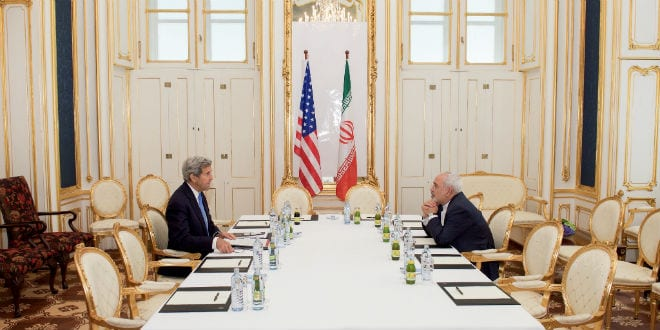 U.S. Secretary of State John Kerry sits across from Iranian Foreign Minister Javad Zarif on July 1, 2015, in Vienna, Austria, before a one-on-one meeting amid negotiations about the future of Iran's nuclear program. (Photo: US State Department)