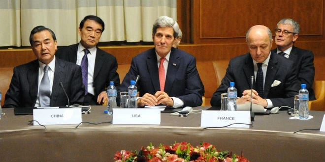 U.S. Secretary of State John Kerry (front, center) sits between Chinese Foreign Minister Wang Yi (left) and French Foreign Minister Laurent Fabius (right) at the United Nations Headquarters after the P5+1 nations reached an interim nuclear deal with Iran in Geneva, Switzerland, on November 24, 2013. (Photo: U.S. State Department)