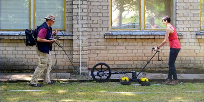 Prof. Harry Jol & Nicole Awad conducting a Ground Penetrating Radar survey at the site of the Great Synagogue of Vilna in Lithuania. (Photo: Jon Seligman/ Israel Antiquities Authority)